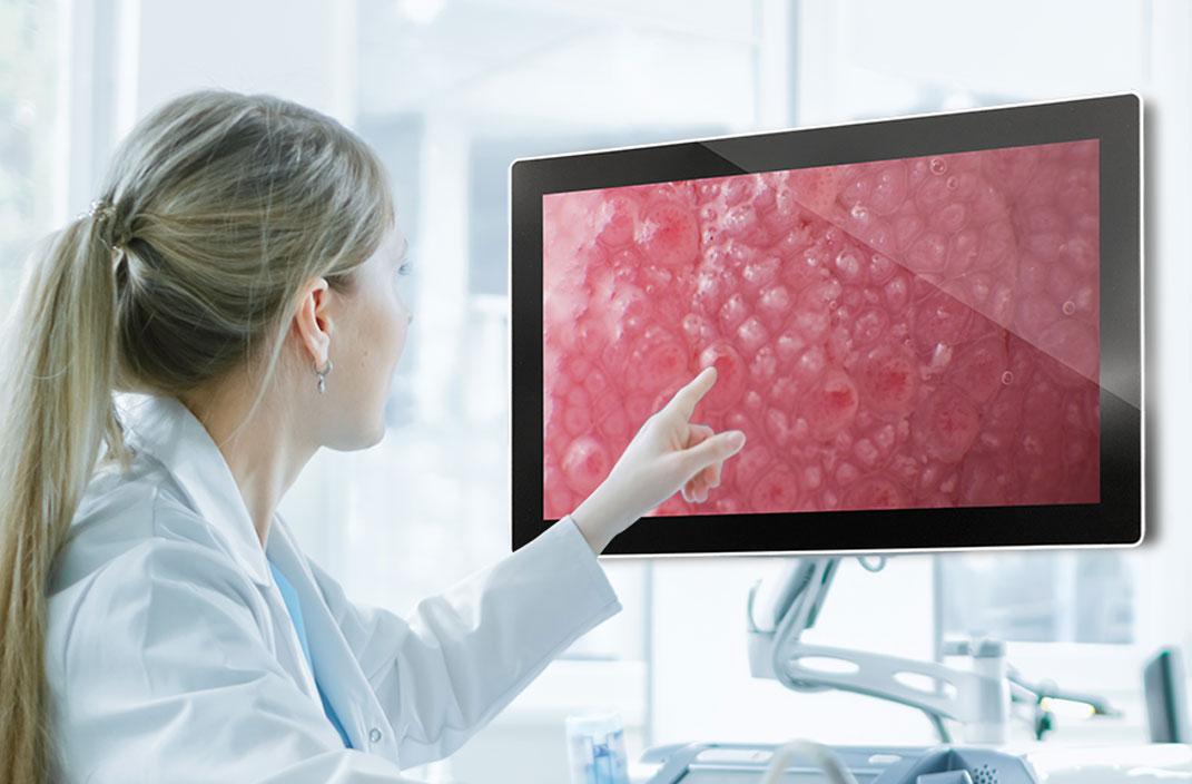 Image showing doctor analyzing/touching medical display