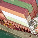Thumbnail: Large Cargo and RoRo (Roll On-Off) ship at sea, loaded with a small amount of shipping containers